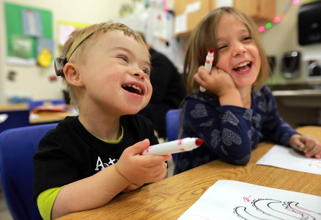 James O'Leary, 4, who was born with Down Syndrome, laughs with classmate Ella Ghidinelli, 3, at the Lattice School in Santa Rosa. (Photo by John Burgess/The Press Democrat)