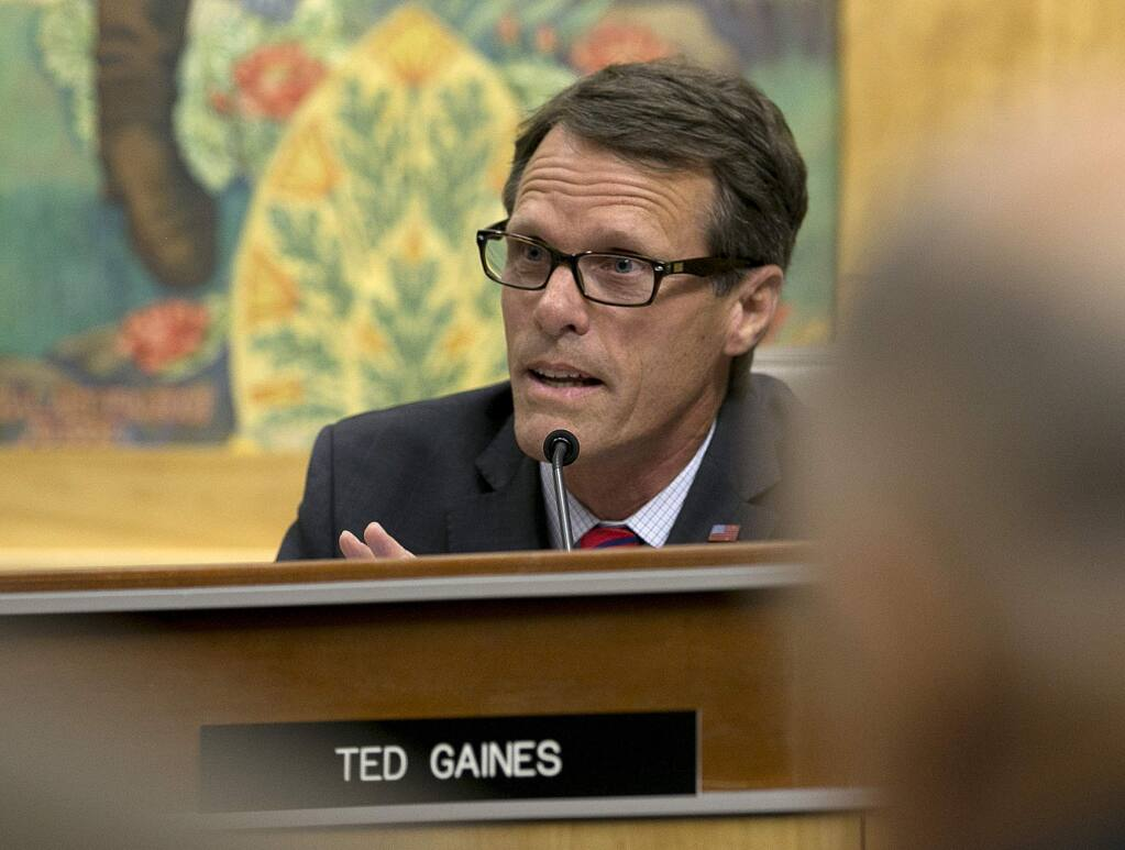 FILE - In this July 13, 2017, file photo, State Sen. Ted Gaines, R-El Dorado Hills, a member of the Senate Environmental Quality Committee, speaks in opposition to a measure to extend the California's cap and trade program that was before the committee in Sacramento, Calif. Sen. Gaines, who represents the Siskiyou County, said on Wednesday, Sept. 13, 2017, that he formally asked the governor for the emergency declaration to compel state officials to help Sheriff Jon Lopey in crack down on the illegal marijuana farms. Gaines said that could include making the California National Guard available to help. (AP Photo/Rich Pedroncelli, File)