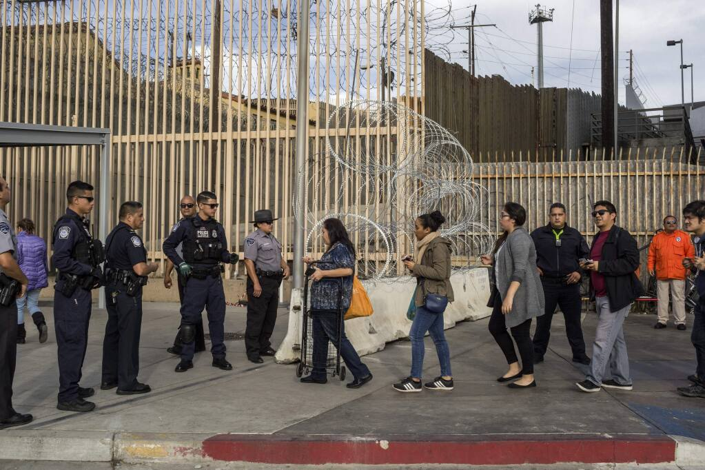 Pedestrians present their documents to U.S. Customs and Border Protection agents at the San Ysidro border crossing. (MAURICIO LIMA / New York Times, 2018)