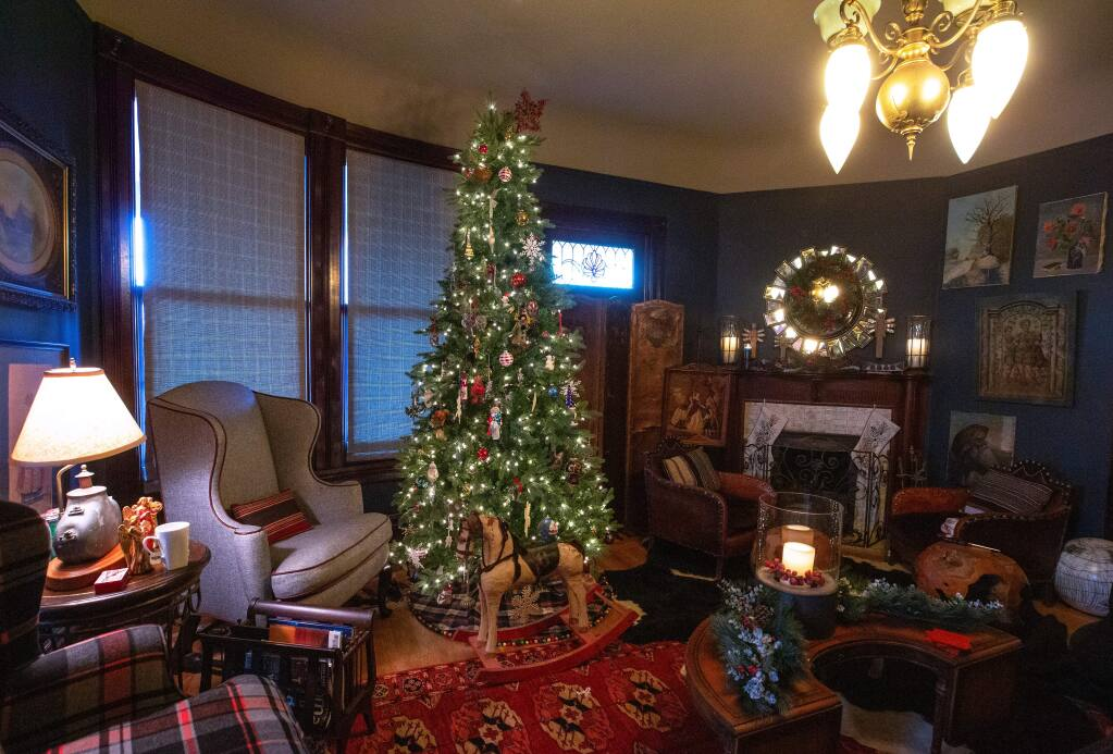 A handmade antique rocking horse sits in front of the Christmas tree inside Bonnie Spindler's Victorian house on Tuesday, Nov. 19, 2019. Spindler's house is part of the upcoming Heritage Homes Christmas Parlor Tour in Petaluma on Sunday, Dec 8. (Alvin Jornada/The Press Democrat)