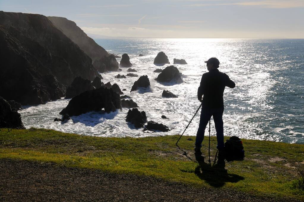 Jim Magill of Walnut Creek prepares to take scenic photos of the coastline at Bodega Head on Friday, Jan. 10, 2020. (CHRISTOPHER CHUNG/ PD)