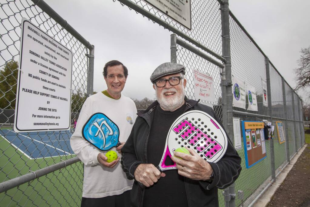 Doubles trouble: Mike Giangreco and Simon Blattner, armed for pickleball and paddle tennis respectively, are on a mission to bring tennis's little siblings to the Valley. (Photo by Robbi Pengelly/Index-Tribune)