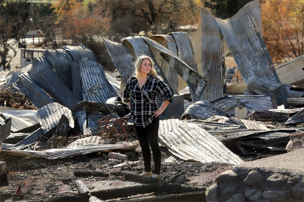 Third generation Cloverleaf Ranch owner Shawna DeGrange stands in the remains of one of the two barns from the 1860's that were lost in the Tubbs Fire. Grange hopes to have the equestrian camp the family has operated for 70 years open by next summer. (photo by John Burgess/The Press Democrat)
