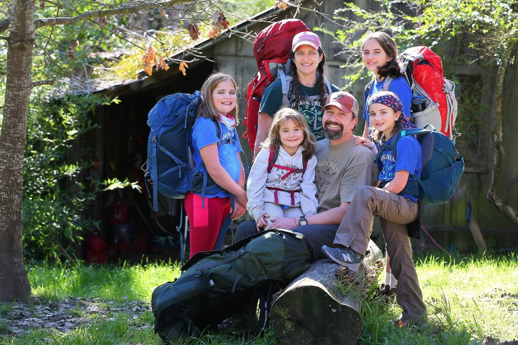 Chris And Jamie Malone, center, are taking their daughters, Harper, left, 10, Sabina, 5, Maya, 12, and Josie, 8, to hike the 2,200 mile Appalachian trail. The family will begin their journey in Georgia,on February 28, and complete the six-month hike in August, ending in Maine. (Christopher Chung/ The Press Democrat)
