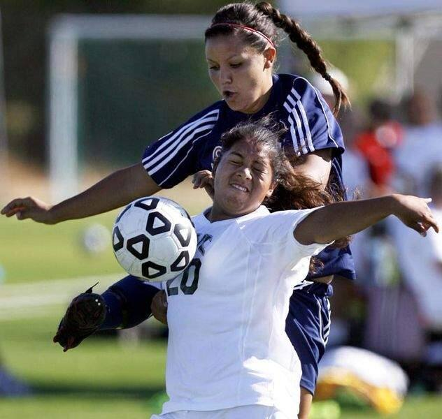 Santa Rosa Junior College's Shelby Stambaugh crosses the ball towards the goal as Diablo Valley College's Fabiola Ramirez tries to block the kick during the game held at Trione Field in Santa Rosa, Tuesday September 30, 2008.