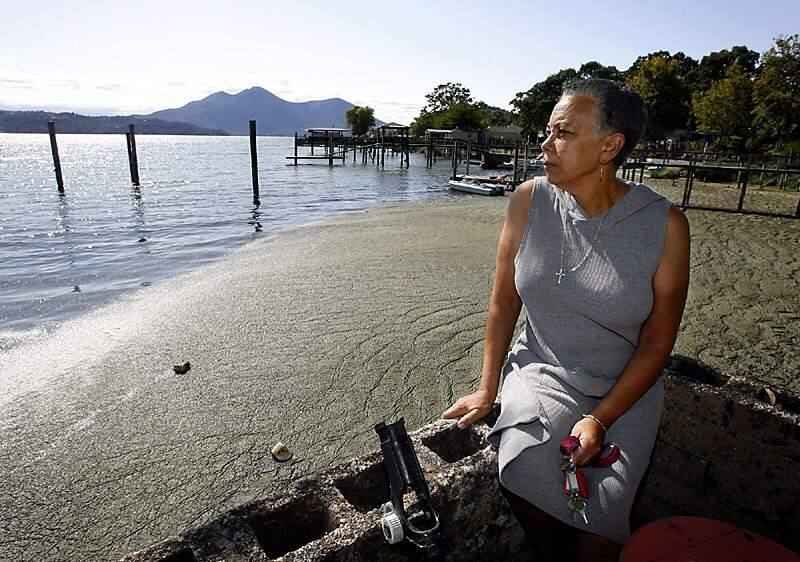 Dian Gibson, owner of Sunset Fishing Resort on Lakeshore Drive in Clear Lake has lost business since June 13th due to the foul odor emitted from the blue-green algae that has washed up into the cul de sac of her property. The Lake County Environmental Health department has posted warnings that the high levels of blue-green algae can produce harmful toxins.