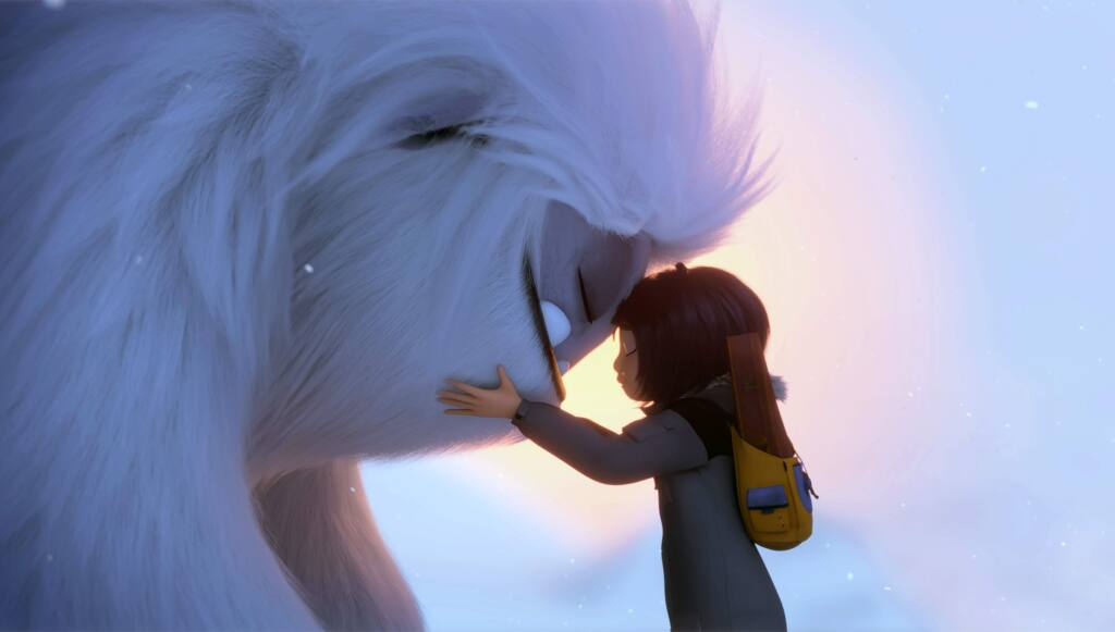 This image released by DreamWorks Animation shows Everest the Yeti, left, and Yi, voiced by Chloe Bennet, in a scene from 'Abominable,' in theaters on Sept. 27. (DreamWorks Animation LLC. via AP)