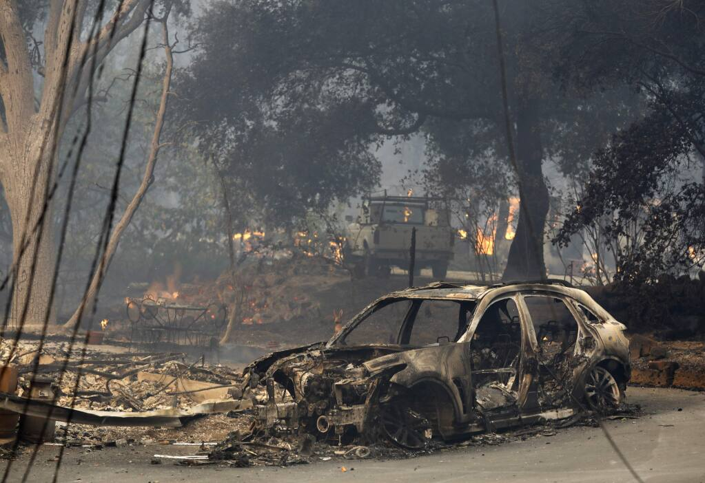 Homes and vehicles ravaged by fire on Warm Springs Road on Monday, Oct. 9, 2017, in Glen Ellen, California . (Beth Schlaner /The Press Democrat)