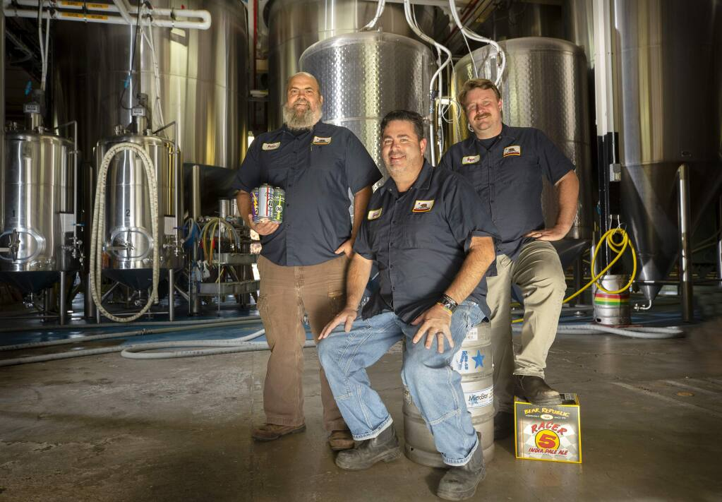 From left, Bear Republic COO Peter Kruger, CEO Richard Norgrove, and Brewmaster Roger Herpst inside their Cloverdale brewery. (photo by John Burgess/The Press Democrat)