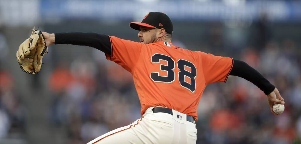 San Francisco Giants pitcher Tyler Beede works against the New York Mets in the first inning Friday, July 19, 2019, in San Francisco. (AP Photo/Ben Margot)
