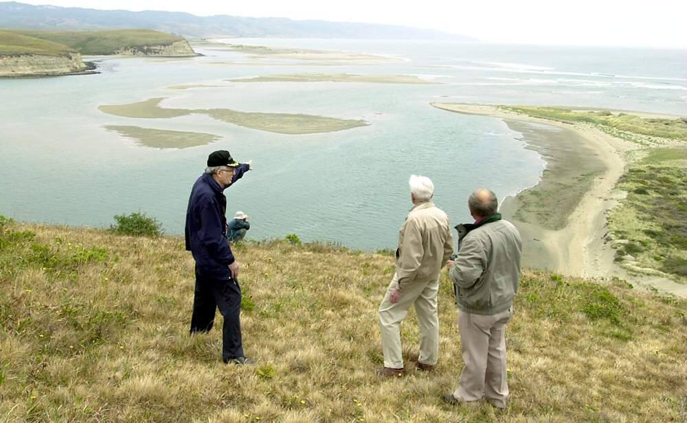 Edward Von der Porten, left, Raymond Aker and Bob Allen of the Drakes Navigator Guild look over Drakes Cove at Point Reyes National Seashore. (CHRISTOPHER CHUNG/ PD FILE, 2001)