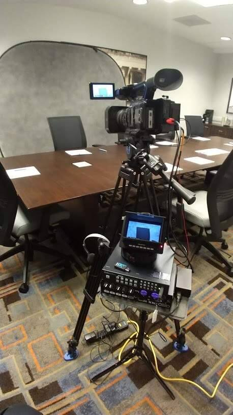 Videographers working with court reporting services have been forced to practice social distancing in getting sworn testimony like depositions in different rooms. Pictured is a setup in a law firm. (Photo by Mike Tunick)