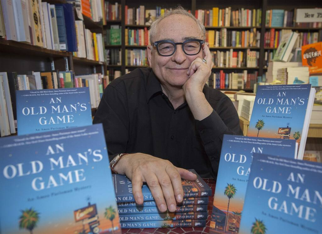 Andy Weinberger, proprietor of Readers Books on East Napa St., with his newly published book 'An Old Man's Game.' (Photo by Robbi Pengelly/Index-Tribune)