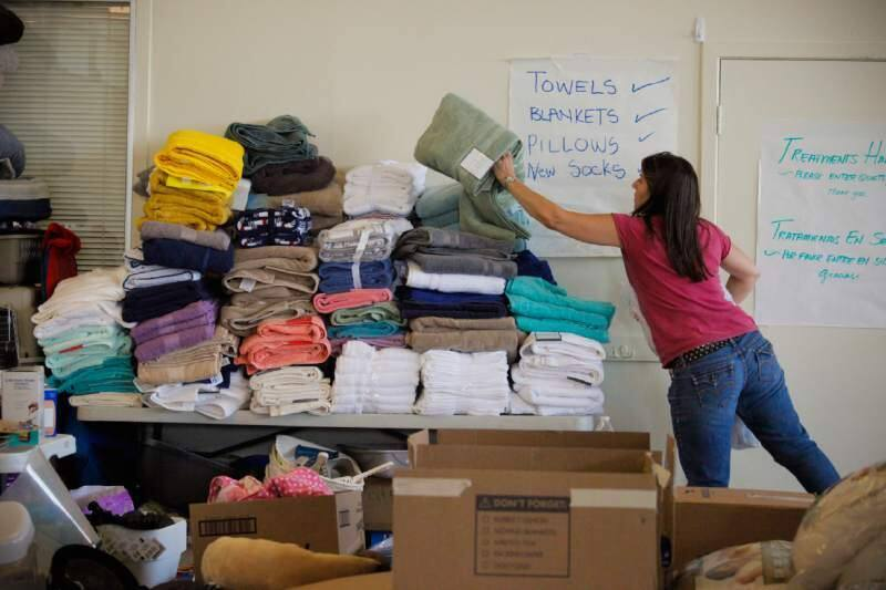 Volunteers in Petaluma help organize the donations they received for the evacuees of the Kincade fire. (CRISSY PASCUAL/ARGUS-COURIER STAFF)