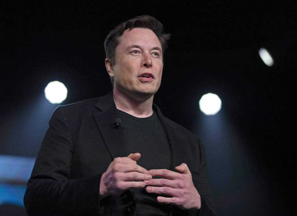 FILE - In this March 14, 2019, file photo, Tesla CEO Elon Musk speaks before unveiling the Model Y at Tesla's design studio in Hawthorne, Calif. Musk is going on trial for his troublesome tweets in a case pitting the billionaire against a British diver he allegedly dubbed a pedophile. (AP Photo/Jae C. Hong, File)