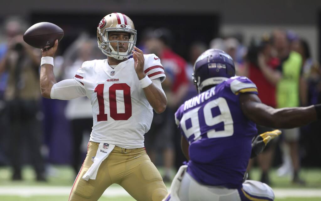 San Francisco 49ers quarterback Jimmy Garoppolo throws a pass over Minnesota Vikings defensive end Danielle Hunter (99) during the second half Sunday, Sept. 9, 2018, in Minneapolis. (AP Photo/Jim Mone)