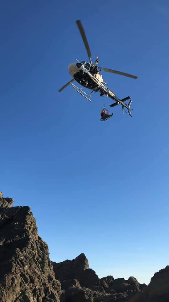 A CHP helicopter rescues a man suffering a medical emergency from Schoolhouse Beach. Photo: Bodega Bay Fire Protection District