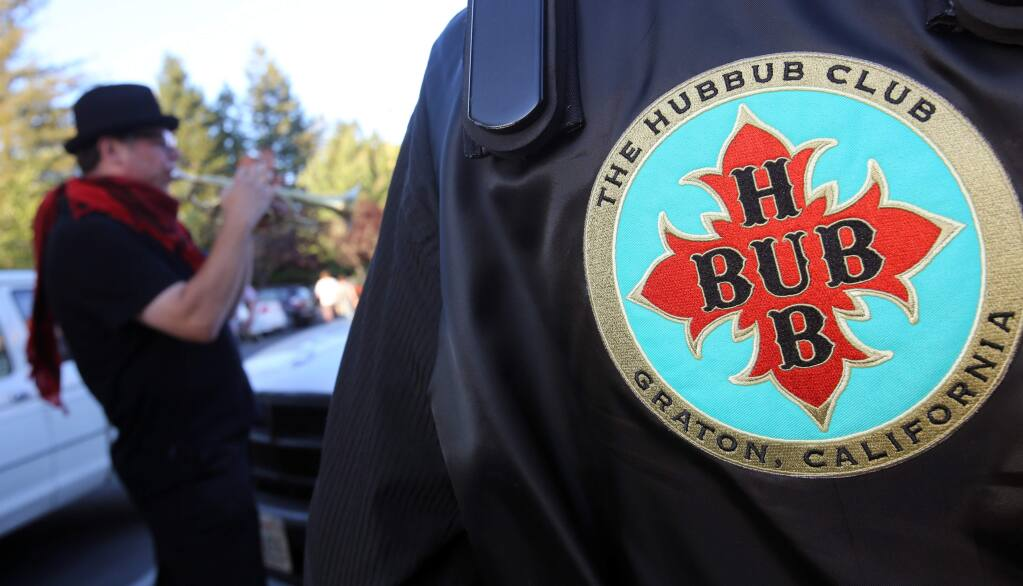 The Hubbub Club's Tony Minner warms up on the Cornet prior to the performance at Aubergine After Dark & Vintage Emporium in Sebastopol, Friday, July 11, 2014. (Crista Jeremiason / The Press Democrat)