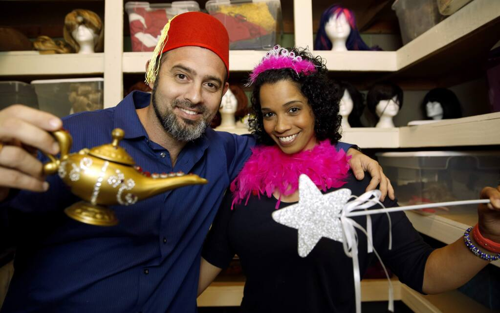 Ariel Werba and his wife Stephanie St. James-Werba are the owners of Amazing Fairytale Parties, that provide party entertainment with characters, activities, and more. Photo taken at their business in Santa Rosa, on Monday, June 22, 2015. (BETH SCHLANKER/ The Press Democrat)