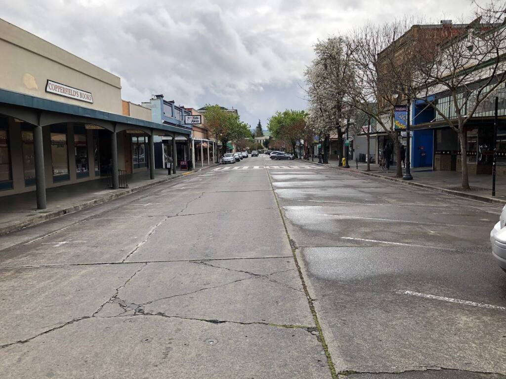 Most of the parking spaces are empty in downtown Petaluma on March 18, the first day of a countywide shelter in place order. MATT BROWN/ARGUS-COURIER STAFF