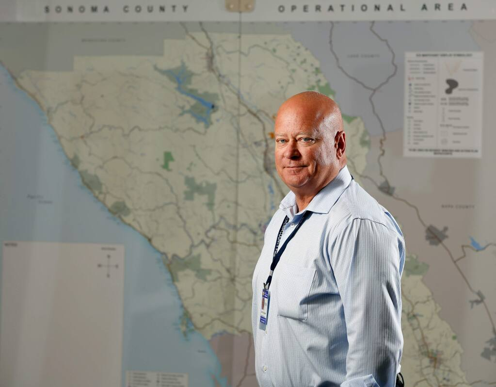 Jim Colangelo, interim director of Sonoma County Fire and Emergency Services, poses for a portrait in front of an operational area map of Sonoma County, at the department's office in Santa Rosa, California, on Tuesday, August 1, 2017. (Alvin Jornada / The Press Democrat)