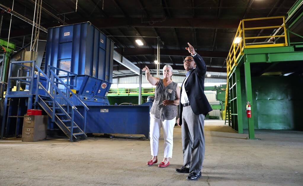 Ratto Group recycle outreach coordinator Lisa Moore, left, gives Rohnert Park councilmember Amy O. Ahanotu a tour of their remodeled recycling facility in Santa Rosa on Wednesday, August 2, 2017. (Christopher Chung/ The Press Democrat)