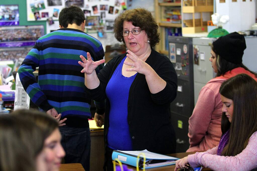 Petaluma High School English teacher Krista O'Connor works with students on an assignment about race and the book 'To Kill a Mockingbird.' (photo by John Burgess/The Press Democrat)