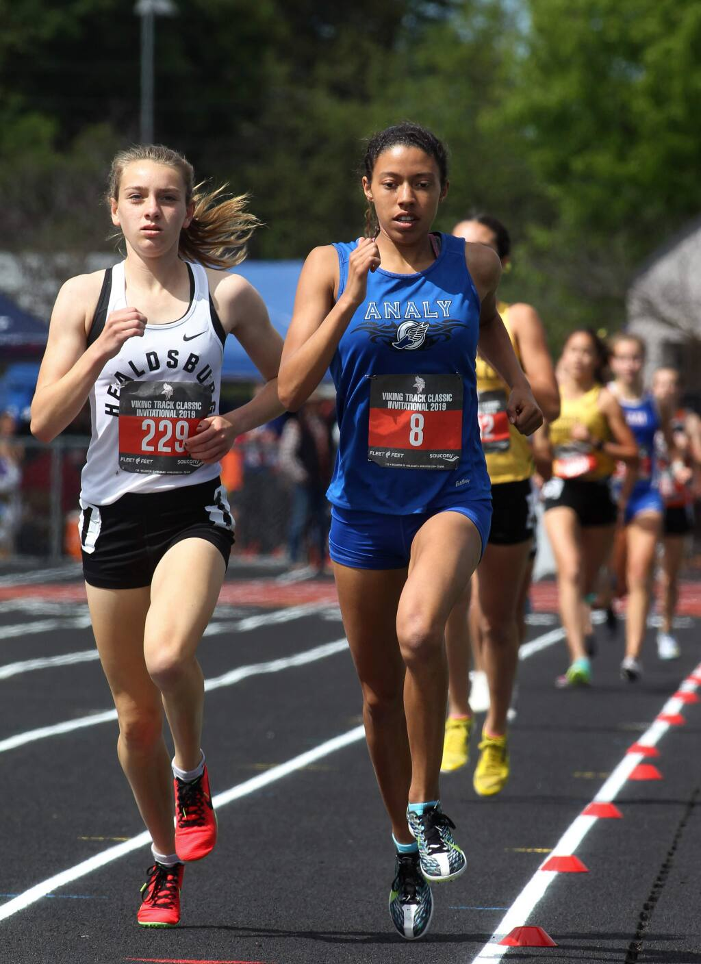 Gabrielle Peterson of Healdsburg High School, left, takes the lead alongside Sierra Atkins of Analy High School, in the 1,600-meter race at the Viking Track Classic at Montgomery High School in Santa Rosa on Saturday, April 20, 2019. (Darryl Bush / For The Press Democrat)