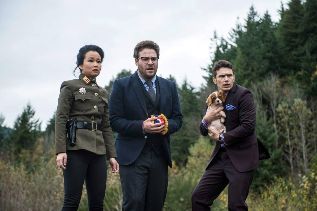 This photo provided by Columbia Pictures - Sony shows, from left, Diana Bang, as Sook, Seth Rogen, as Aaron, and James Franco, as Dave, in Columbia Pictures' 'The Interview.' (AP Photo/Columbia Pictures - Sony, Ed Araquel)