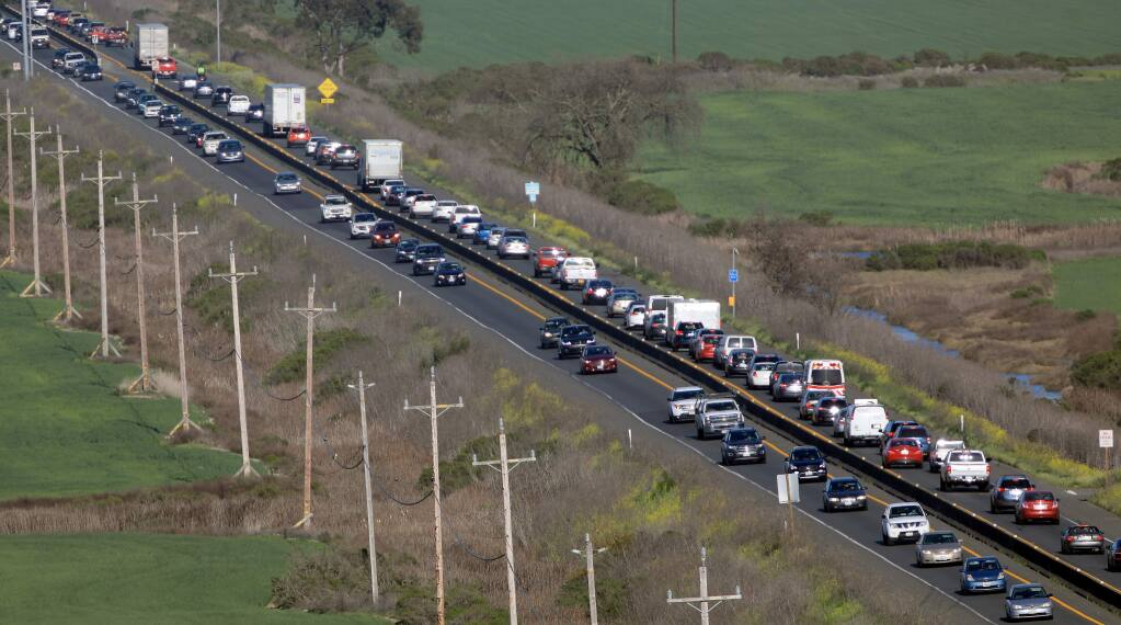 Commute traffic backs up along east- and westbound Highway 37 on April 2. (KENT PORTER / The Press Democrat, 2018)