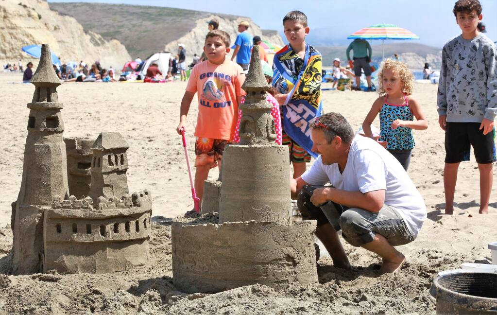 Dan Baker carves the details into his castle at the 38th annual Sand Sculpture Contest at Drakes Beach, Point Reyes National Seashore on Saturday Aug. 25, 2019. (WILL BUCQUOY/FOR THE PD)