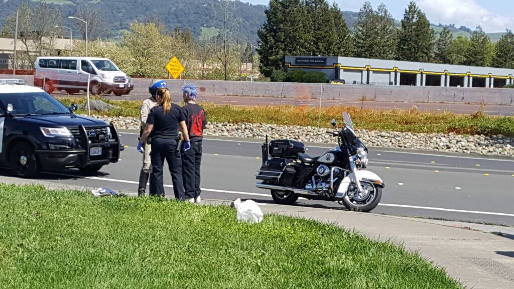 A CHP officer speaks with the driver (right) of a vehicle that crashed off Highway 101 in Rohnert Park on Thursday, March 23, 2017. (COURTESY OF REGINALD GUILLORY)