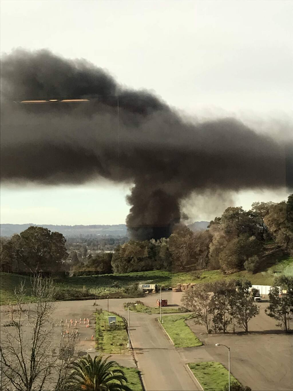 A large truck driving on Fountaingrove Parkway slammed into multiple vehicles, catching fire and sending a huge plume of dark smoke over the northern end of Santa Rosa on Monday, Feb. 5, 2018. (COURTESY OF TINA MONTGOMERY)