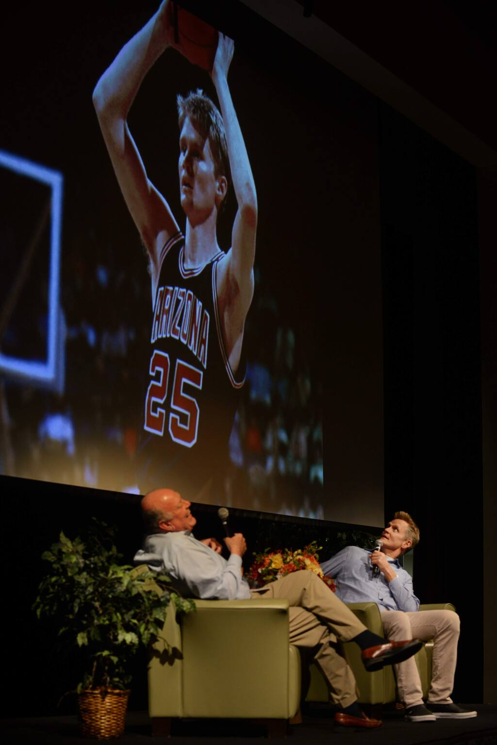 Head Coach of the Golden State Warriors Steve Kerr, right, checking out an old photo from his college days during a conversation with former Head Coach and General Manager of the Warriors Garry St. Jean, left, at the Sonoma Speakers Series held Monday evening at Hanna Boys Centerin Sonoma, California. October 1, 2018.(Photo: Erik Castro/for The Press Democrat)