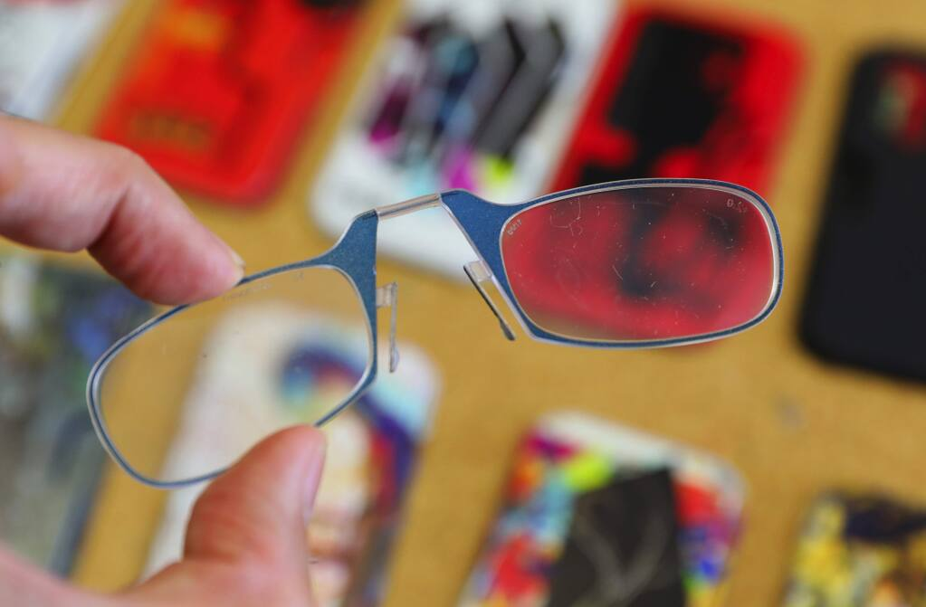 ThinOPTICS portable reading glasses are thin foldable glasses that can be kept in a small case, meant to be carried everywhere.(Christopher Chung/ The Press Democrat)