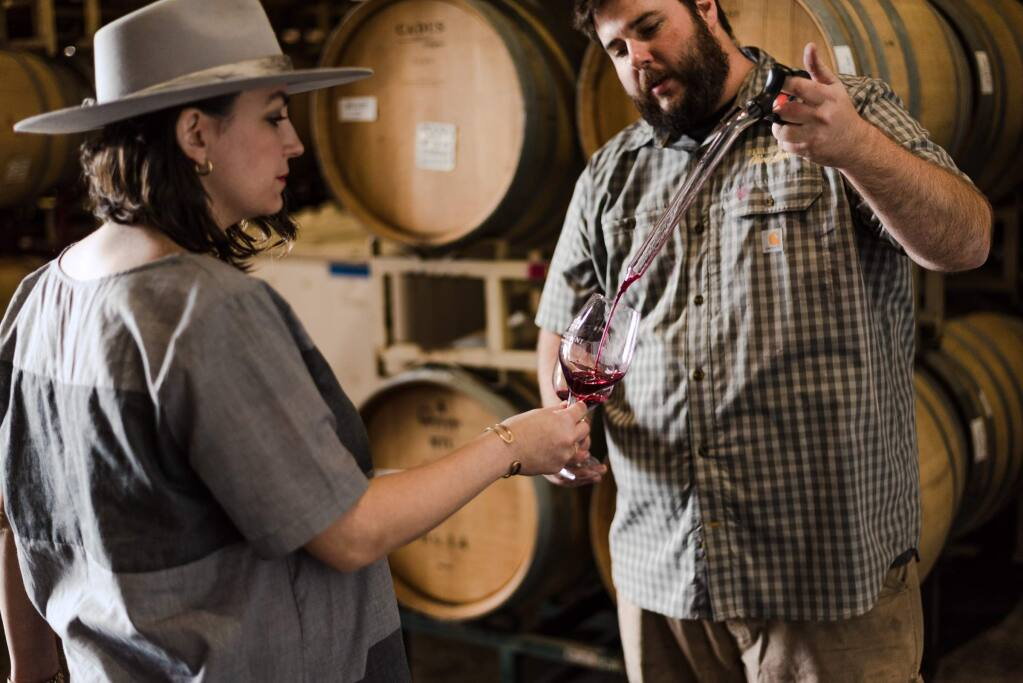 Winemaker Charlie Fauroat is pictured with Alexia Pellegrini, fourth-generation vintner and general manager. (Olivet Lane Vineyard)
