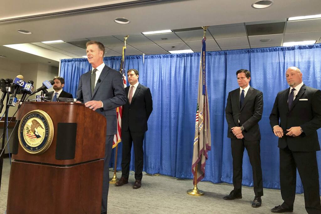 US attorney David Anderson announces criminal spy charges against a San Francisco Bay Area tour operator Xuehua Edward Peng Monday, Sept. 30, 2019, in San Francisco. Xuehua Edward Peng, who operates tours for Chinese students and visitors, was charged with being an illegal foreign agent and delivering classified U.S. national security information to officials in China, U.S. government officials announced Monday. (AP Photo/Janie Har)
