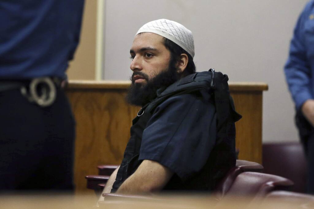 FILE - In this Dec. 20, 2016 file photo, Ahmad Khan Rahimi, the man accused of setting off bombs in New Jersey and New York's Chelsea neighborhood, sits in court in Elizabeth, N.J. Rahimi, an Islamic terrorist already serving a life prison term for a bombing in New York City, was convicted Tuesday, Oct. 8, 2019, of multiple counts of attempted murder and assault stemming from a shootout with police three years ago in New Jersey. (AP Photo/Mel Evans, File)