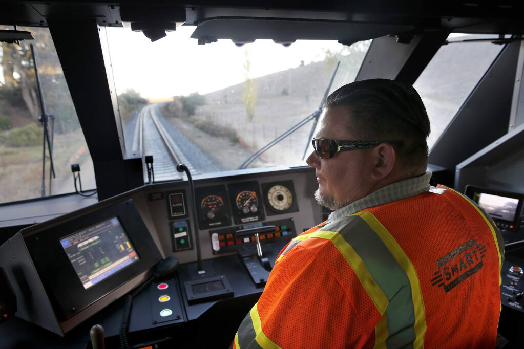Controller supervisor Matt Shiffrar drives the SMART train along a section during speed testing through 'The Narrows' in Novato, on Tuesday, November 3, 2015. (BETH SCHLANKER/ The Press Democrat)