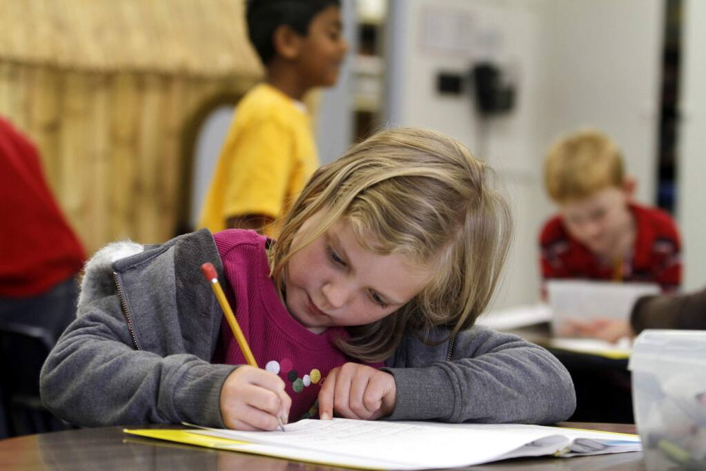 First grader Charlotte Williams, 6, works on a writing composition during class at Liberty Elementary School on Thursday, June 2, 2011, in Petaluma. (BETH SCHLANKER/ The Press Democrat)