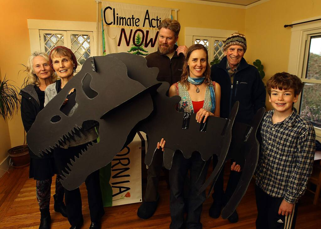 Sebastopol residents, left to right, Anna Jacopetti, Janet Powers Wolfe, Wyndham and Sunny Galbraith, Roland Jacopetti and Leo Galbraith, 10, with the dinosaur head they will take to the Oakland anti-fracking rally on Sunday. (Photo by John Burgess/The Press Democrat)