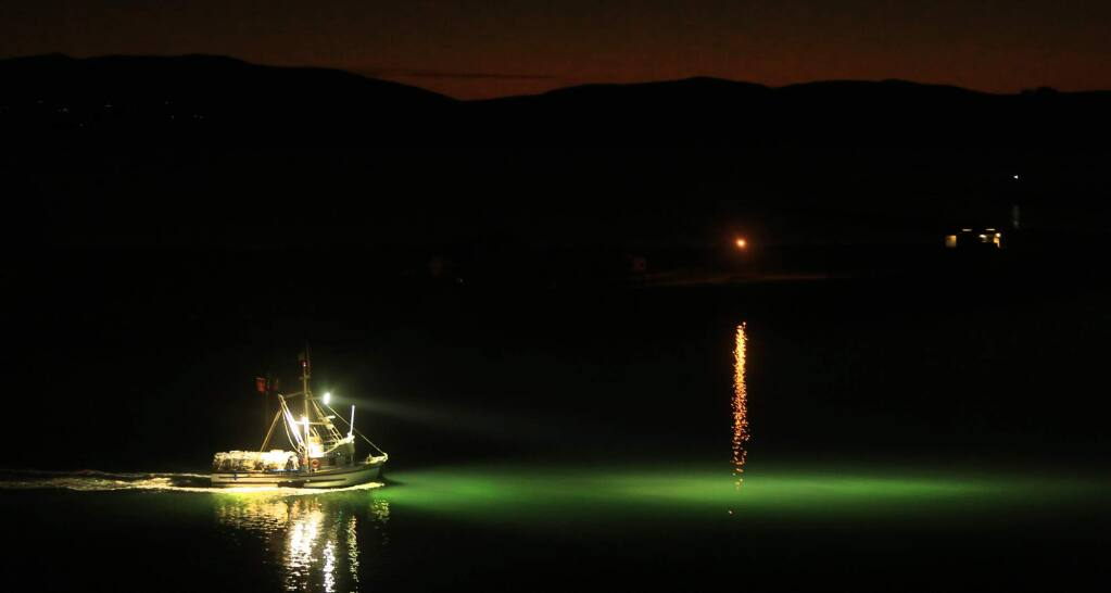 Skipped by Tony Anello, the Annabelle heads out in smooth bay waters to place crab pots during the opening of the season, Friday Dec, 2, 2016 in Bodega Bay. (Kent Porter / The Press Democrat) 2016