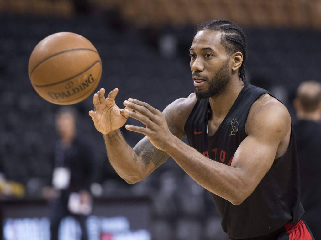 The Toronto Raptors' Kawhi Leonard passes during practice for the NBA Finals in Toronto on Wednesday, May 29, 2019. Game 1 of the NBA Finals between the Raptors and Golden State Warriors is Thursday in Toronto. (Frank Gunn/The Canadian Press via AP)