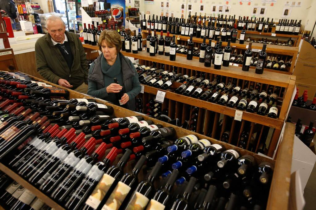 Marlene and Buzz McNaughton, visiting from Pittsburg, Pennsylvania, choose a selection of wines at Bottle Barn in Santa Rosa, California, on Wednesday, January 24, 2018. Wine shipments in volume increased 1.3 percent and overall wine sales increased almost three percent last year, according to the Unified Wine and Grape Symposium. (Alvin Jornada / The Press Democrat)