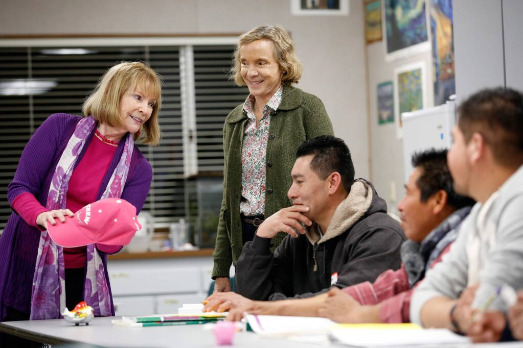 Lynn Horowitz, standing at center, director of the Alexander Valley Adult and Family ESL, observes one of the program classes taught by instructor Sylvie Anne Moore, left, at the Alexander Valley School, in Healdsburg, California on Thursday, Jan. 19, 2017. Funders include Community Foundation Sonoma County, John Jordan Foundation, Our Family Foundation and Uplands Family Foundation. (Alvin Jornada / The Press Democrat)