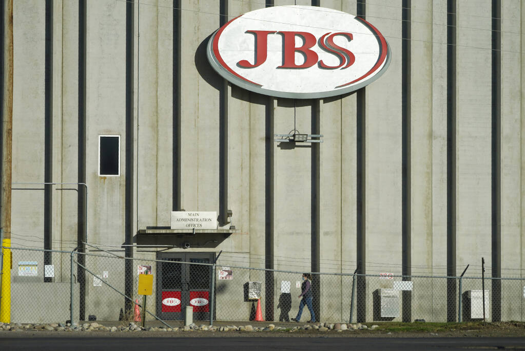 Hold For Release on Friday, Oct. 30, With Patty Nieberg Story slugged Virus Outbreak Lives Lost Meat Plant—A worker heads into the JBS meat packing plant Monday, Oct. 12, 2020, in Greeley, Colo. (AP Photo/David Zalubowski)