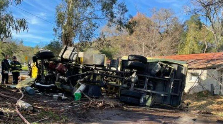 Two people were injured in a crash involving an overturned tree trimming truck that closed part of  Grove Street in Sonoma for several hours on Thursday, Feb. 4, 2021. (Sonoma Valley Fire District / Facebook)