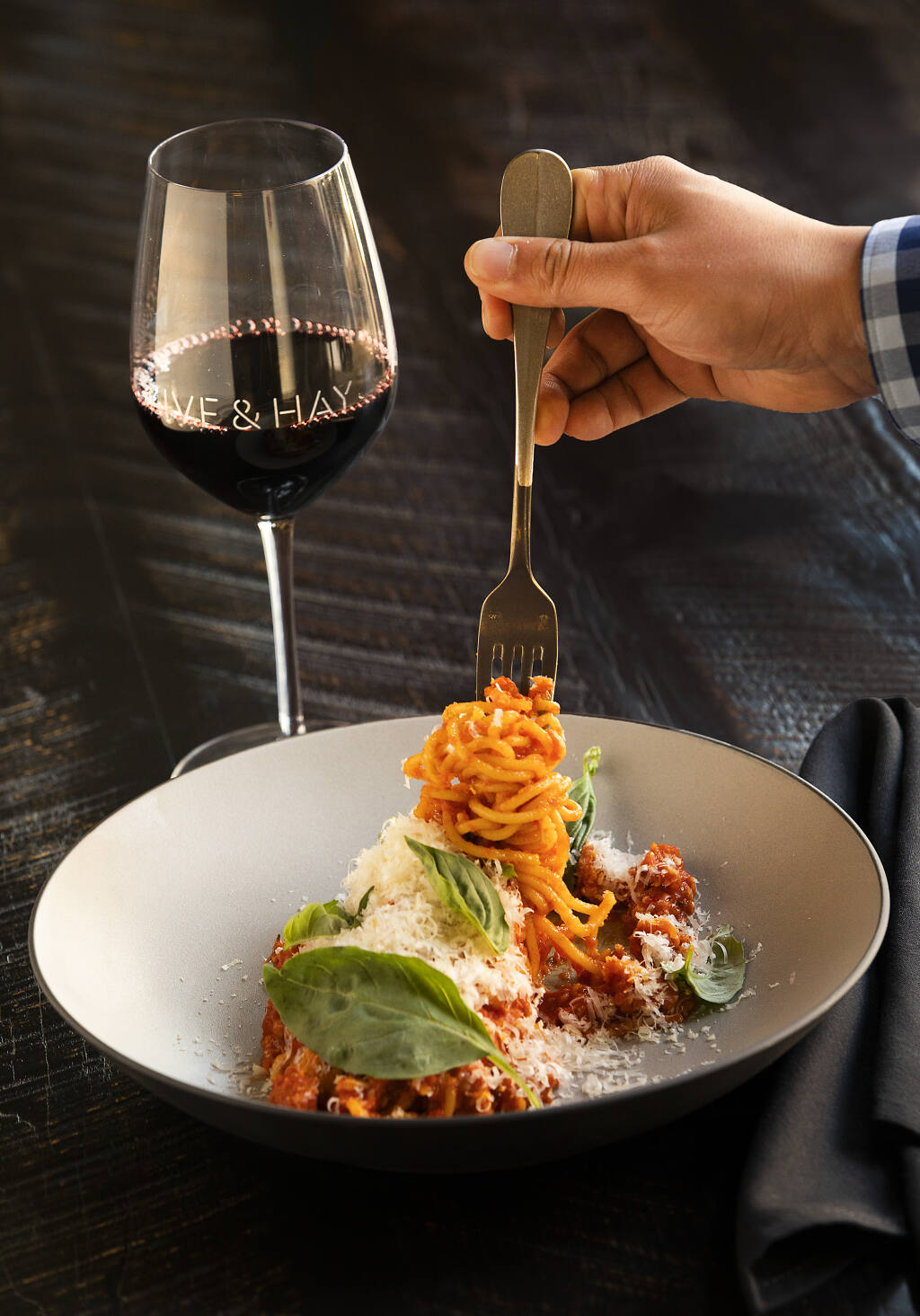 Spaghetti with house made calabrese sausage,tomato conserva and mozzarella from Olive & Hay in the Meritage Resort and Spa in Napa. (John Burgess/The Press Democrat)