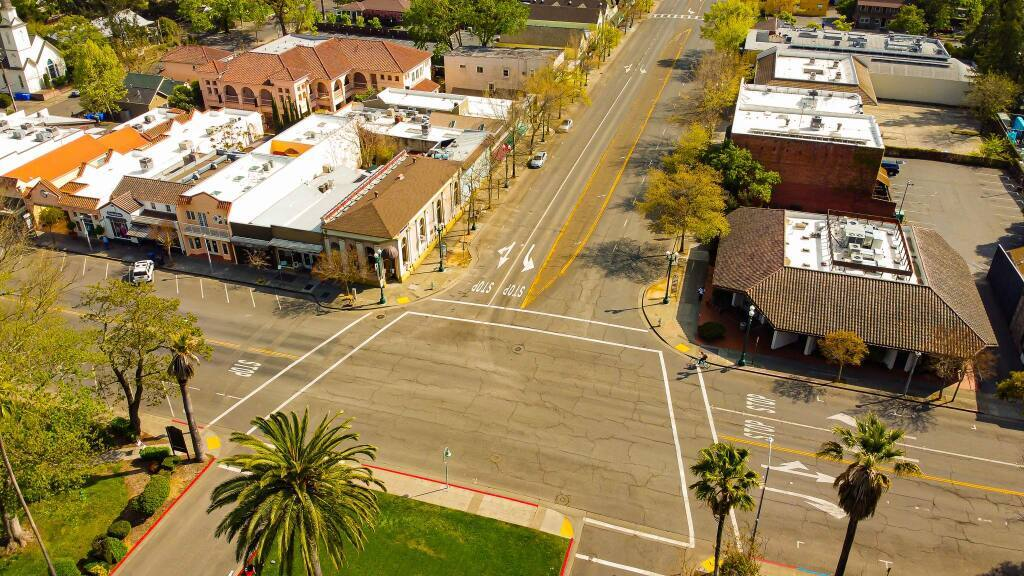 The restriping plan on the five-lane Broadway will eliminate the center divide and one southbound lane in order to make room for bike lanes and a shorter pedestrian crossing.