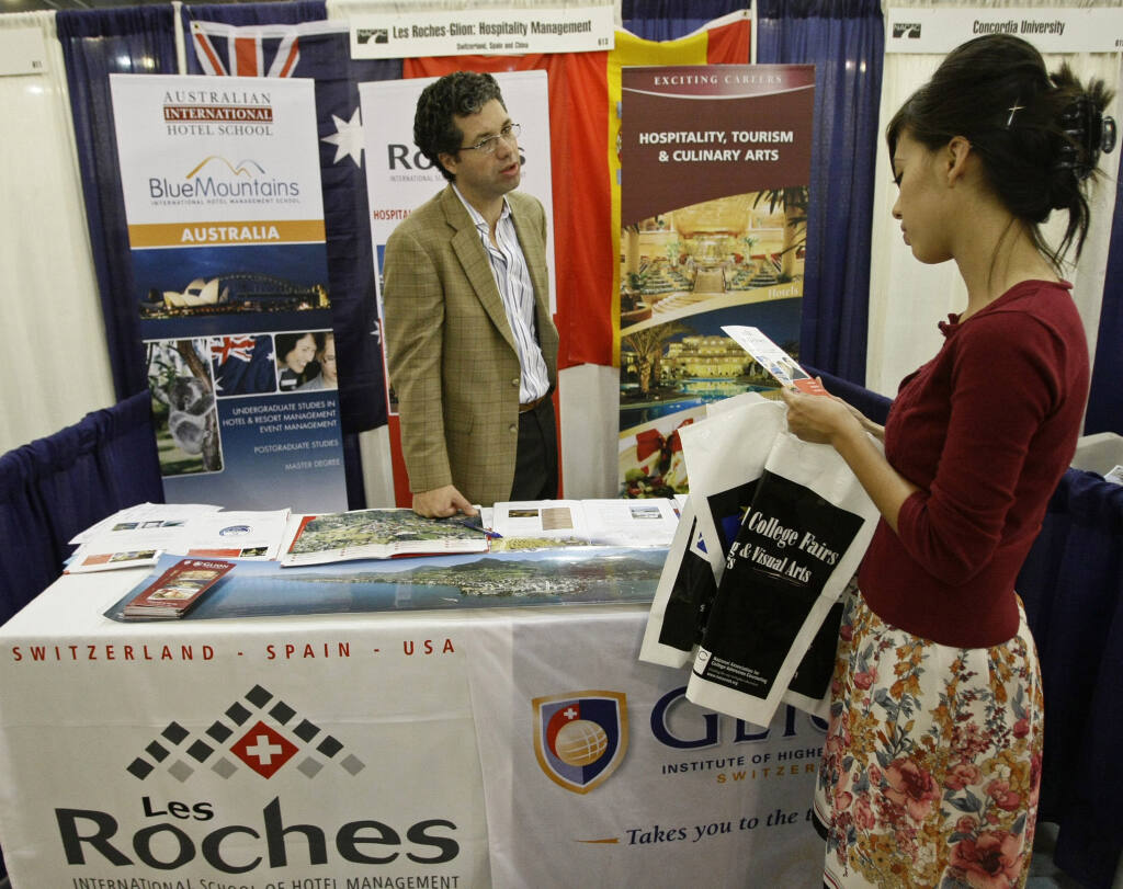 The days of the traditional college fair are gone - for now. (AP Photo/Damian Dovarganes)